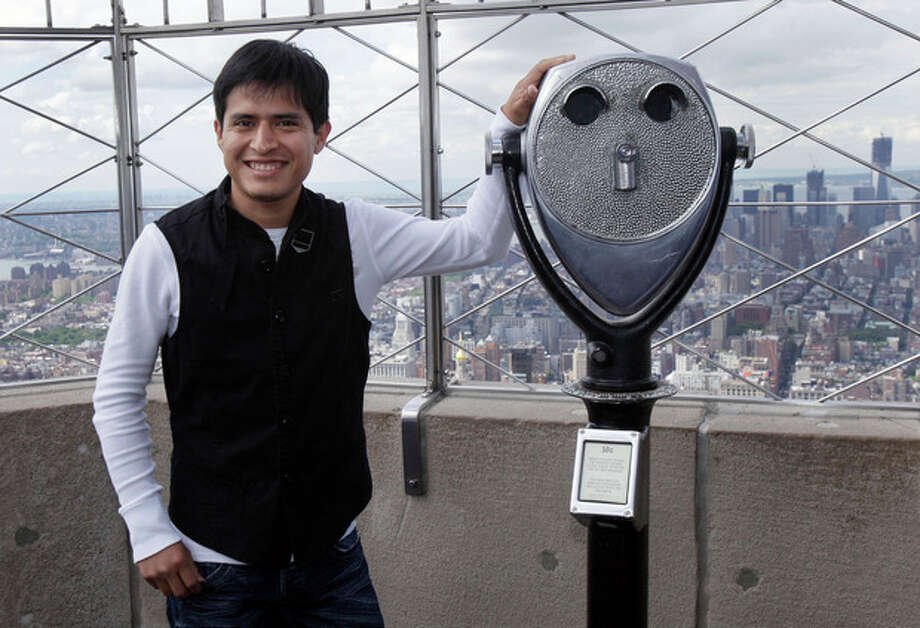 Mario Gutierrez, from Mexico, jockey for Kentucky Derby and Preakness winner I'll Have Another, poses on the observation deck of New York's Empire State Building, Tuesday, June 5, 2012. I'll Have Another could become horse racing's 12th Triple Crown winner and first in 34 years on Saturday at the Belmont Stakes. (AP Photo/Richard Drew) / AP