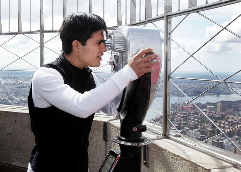 Mario Gutierrez, from Mexico, jockey for Kentucky Derby and Preakness winner I'll Have Another, looks over Manhattan from the observation deck of New York's Empire State Building, Tuesday, June 5, 2012. I'll Have Another could become horse racing's 12th Triple Crown winner and first in 34 years on Saturday in the Belmont Stakes.(AP Photo/Richard Drew) / AP