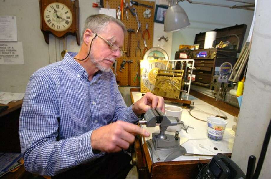Photo/Alex von Kleydorff. J.C. Woodward works on straightening a minute pipe on a 20th century tubular chime hall clock