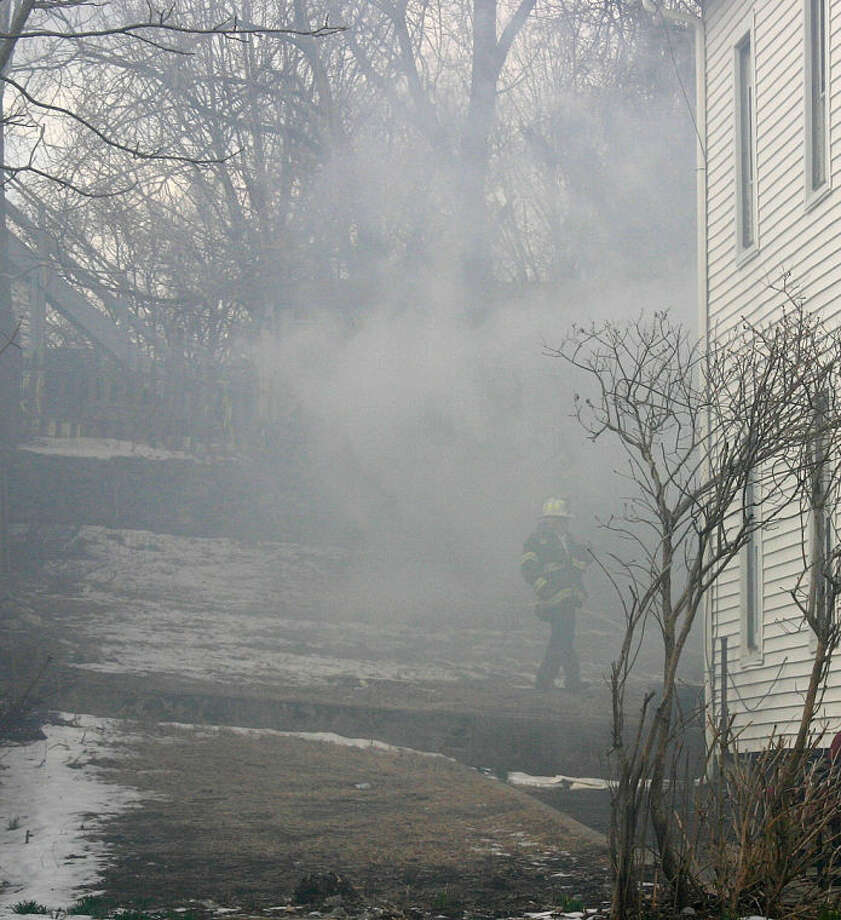 Photo by Chris Bosak Norwalk Firefighters respond to a garage fire on Woodward Ave. on the morning of Wednesday, March 20.