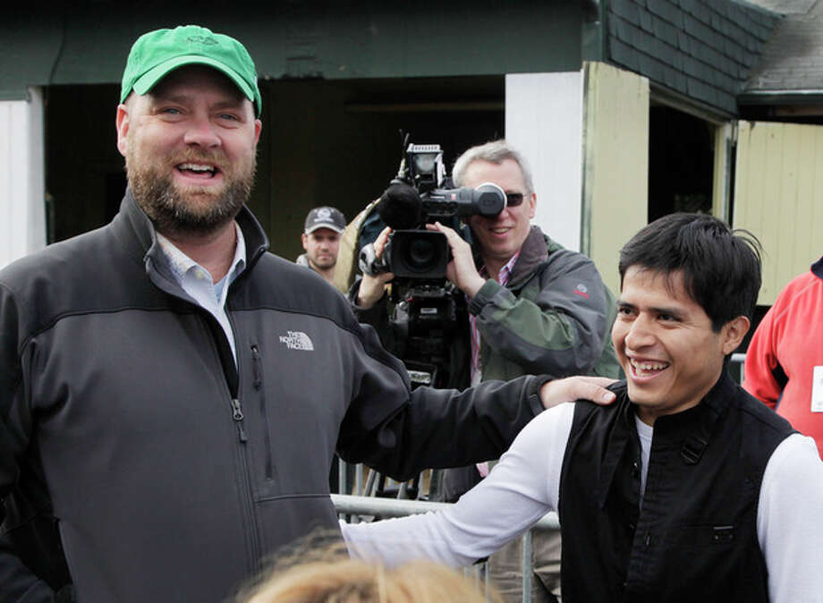 Trainer Doug O'Neill, left, and jockey Mario Gutierrez talk with reporters at Belmont Park in Elmont, N.Y., Tuesday, June 5, 2012. Gutierrez, who rode I'll Have Another to wins at the Kentucky Derby and Preakness, will try for horse racings Triple Crown with O'Neill's horse in Saturday's Belmont Stakes. (AP Photo/Mark Lennihan) / AP