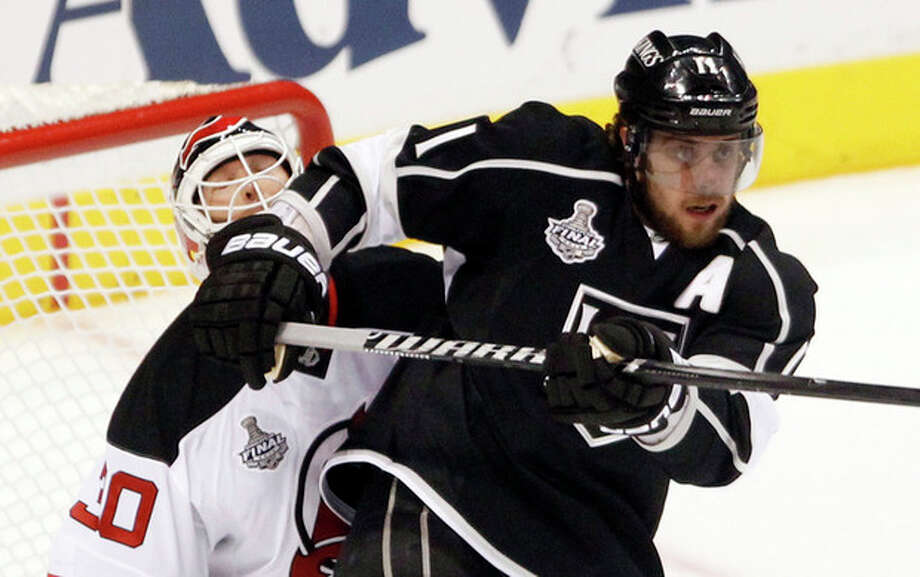 Los Angeles Kings' Anze Kopitar, of Slovenia, right, bumps New Jersey Devils' goalie Martin Brodeur in the first period during Game 4 of the NHL hockey Stanley Cup finals, Wednesday, June 6, 2012, in Los Angeles. (AP Photo/Jae C. Hong) / AP
