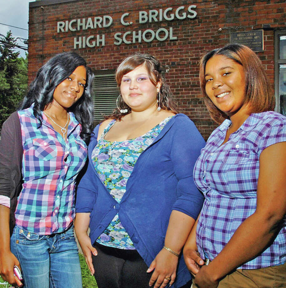 Hour photo / Erik TrautmannBriggs High School seniors Leshawn Mathis, Jasmine Coreano and Geornell Rodriguez are the first graduates to go on to college outside of Norwalk. / (C)2012, The Hour Newspapers, all rights reserved