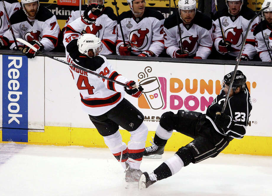 New Jersey Devils' Bryce Salvador (24) and Los Angeles Kings' Dustin Brown (23) collide in the first period during Game 4 of the NHL hockey Stanley Cup finals, Wednesday, June 6, 2012, in Los Angeles. (AP Photo/Jae C. Hong) / AP