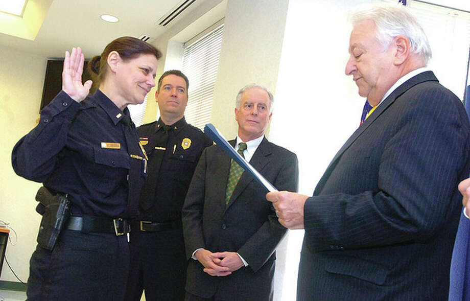 Hour Photo/Alex von Kleydorff . Mayor Richard Moccia swears in new Norwalk Police Deputy Chief Susan Zecca / 2013 The Hour Newspapers