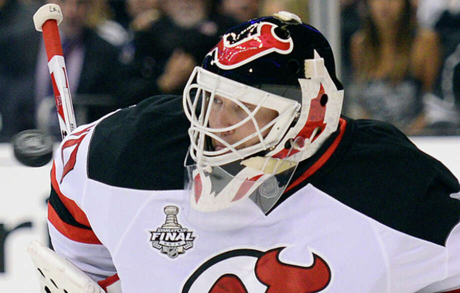 The puck approaches New Jersey Devils' Martin goalie Martin Brodeur in the second period during Game 4 of the NHL hockey Stanley Cup finals against the Los Angeles Kings, Wednesday, June 6, 2012, in Los Angeles. (AP Photo/Mark J. Terrill) / AP