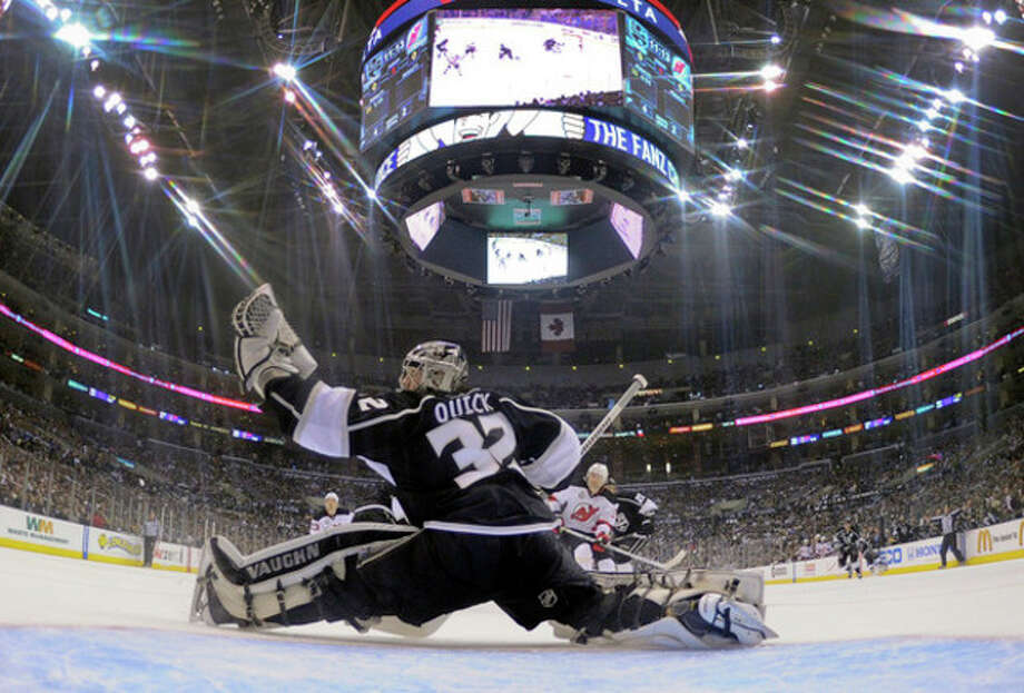 Los Angeles Kings goalie Jonathan Quick (32) stops a shot on the goal in the second period during Game 4 of the NHL hockey Stanley Cup finals against the New Jersey Devils, Wednesday, June 6, 2012, in Los Angeles. (AP Photo/Harry How, Pool) / AP
