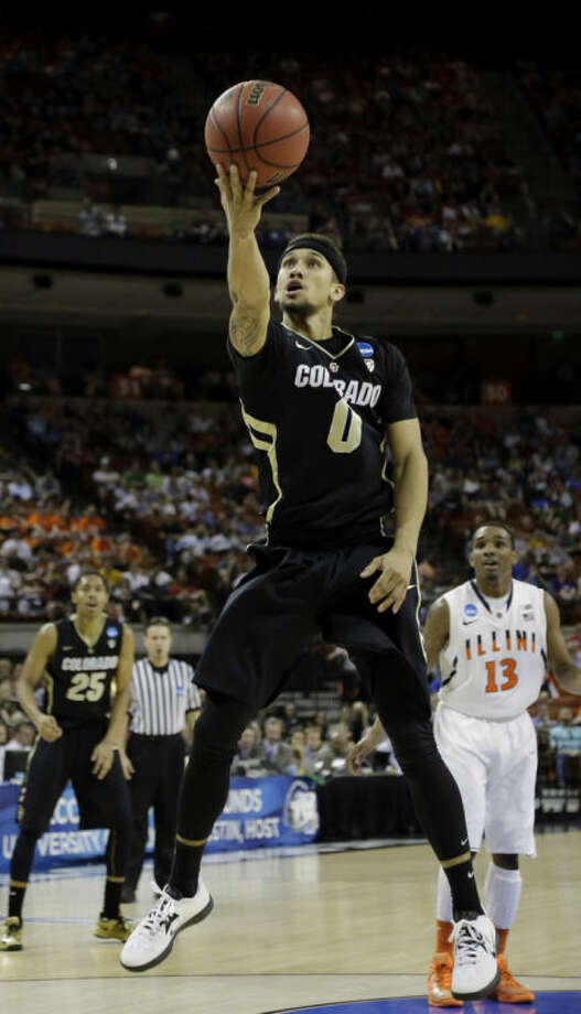 Colorado's Askia Booker (0) shoots against Illinois during the first half of a second-round game of the NCAA college basketball tournament on Friday, March 22, 2013, in Austin, Texas. (AP Photo/David J. Phillip)