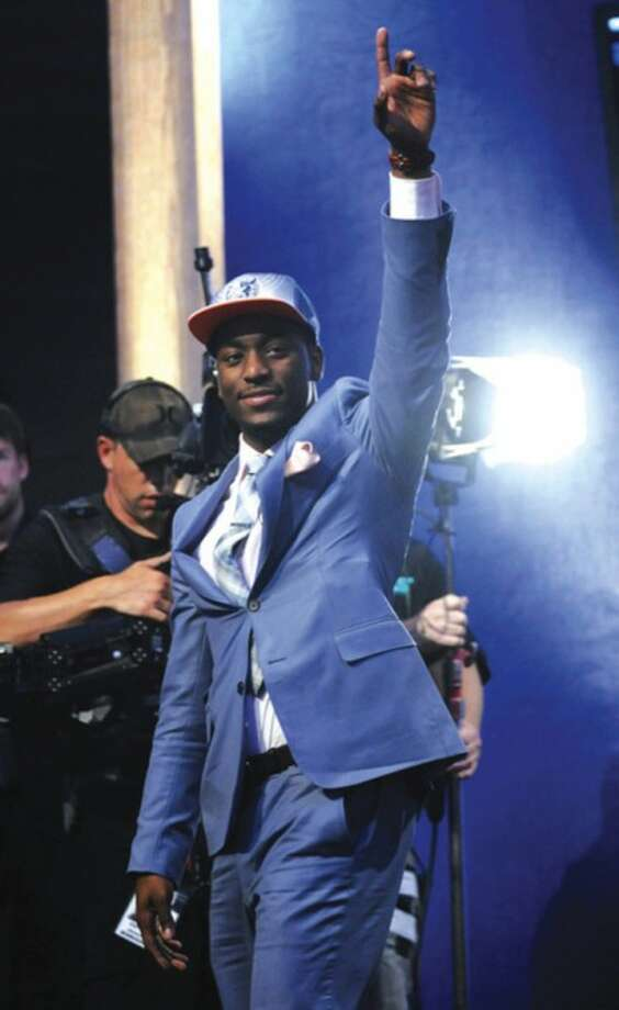 AP photo UConnÕs Kemba Walker waves to the crowd after being selected by the Charlotte Bobcats with the No. 9 pick in Thursday nightÕs NBA draft.
