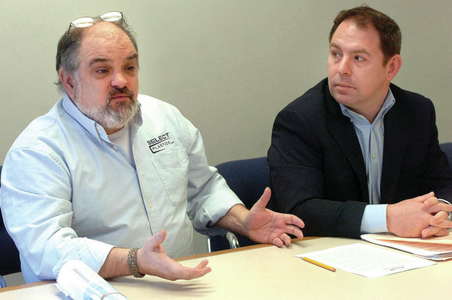 Hour photo / Alex von KleydorffNorwalk Harbor Commission member Tony D'Andrea next to Commisson Chairman Jose Cebrian speaks during a press conference announcing a Norwalk River dredging project. / 2013 The Hour Newspapers