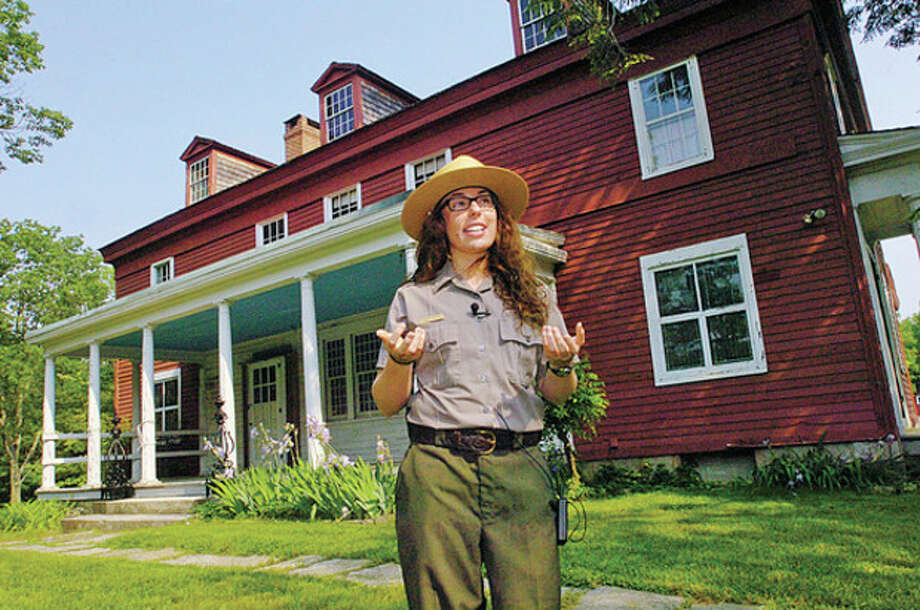 Hour photo / Erik Trautmann Park Ranger at Weir Farm, Cassie Werne, speaks in front of the main house at the site in Wilton in this file photo. / (C)2011, The Hour Newspapers, all rights reserved