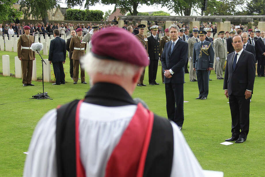 British minister of Defense Philippe Hammond, rear left and French President Francois Hollande, center, attends at the ceremony commemorating the 68th anniversary of the D-Day invasion of France began in 1944, in the British war cemetery of Ranville, western France, Wednesday, June 6, 2012. (AP Photo/David Vincent, Pool) / AP