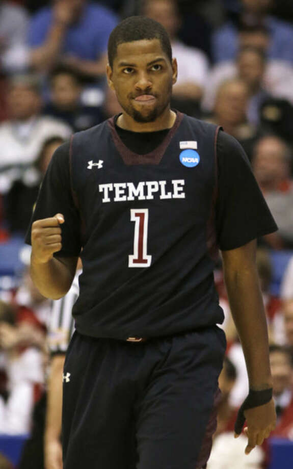 Temple guard Khalif Wyatt clinches his fist as he walks up court during the second half of a second-round game against the North Carolina State at the NCAA college basketball tournament, Friday, March 22, 2013, in Dayton, Ohio. (AP Photo/Al Behrman)