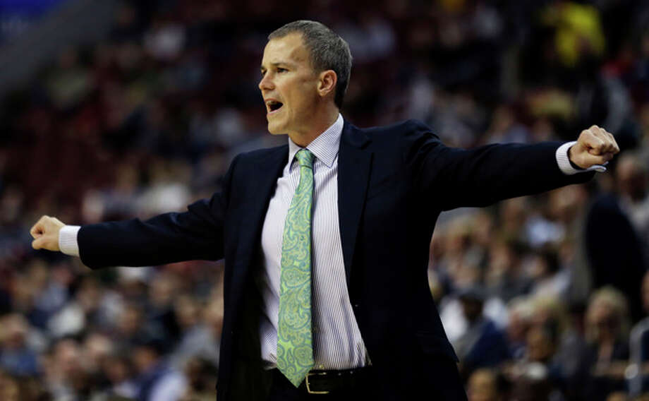 Florida Gulf Coast head coach Andy Enfield reacts during the first half of a second-round game against Georgetown during the NCAA college basketball tournament on Friday, March 22, 2013, in Philadelphia. (AP Photo/Matt Rourke) / AP