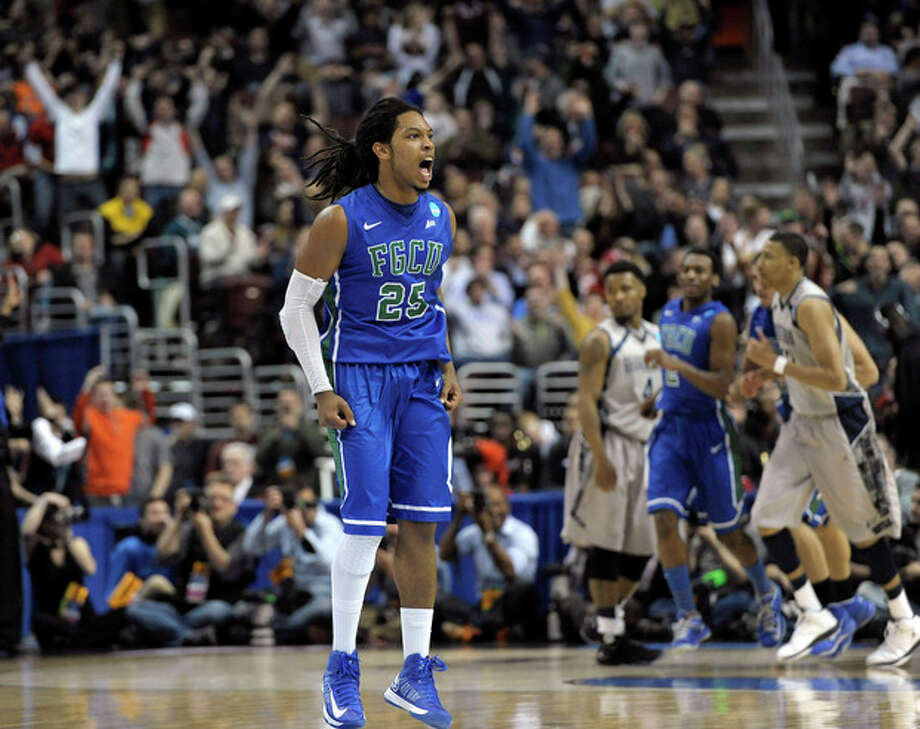 Florida Gulf Coast's Sherwood Brown reacts after a making a basket during the second half of a second-round game against Georgetown in the NCAA college basketball tournament, Friday, March 22, 2013, in Philadelphia. (AP Photo/Michael Perez) / FR168006 AP