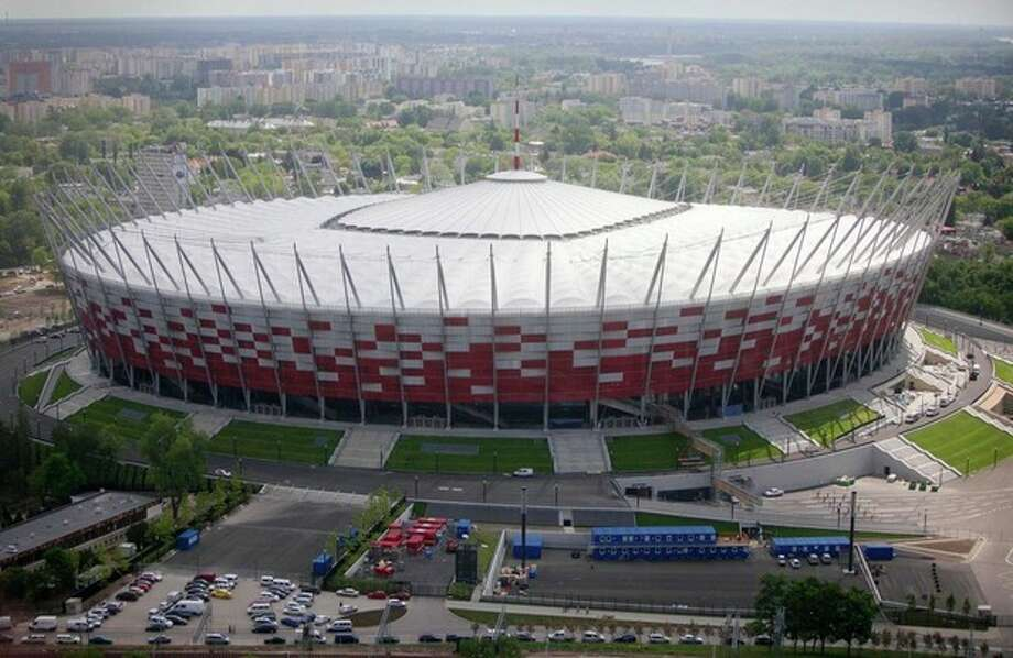 FILE - The aerial view made from a hot air balloon shows the new National Stadium, ready for the Euro 2012 football games, in Warsaw, Poland on Friday, May 18, 2012. The stadium is located in one of Warsaw's most popular neighborhoods: Saska Kepa, an enclave of towering trees and homes built in the modernist style of the 1920s and 1930s. The Euro 2012 soccer championship kicks off Friday, June 8, 2012.(AP Photo/Czarek Sokolowski) / 2012 AP