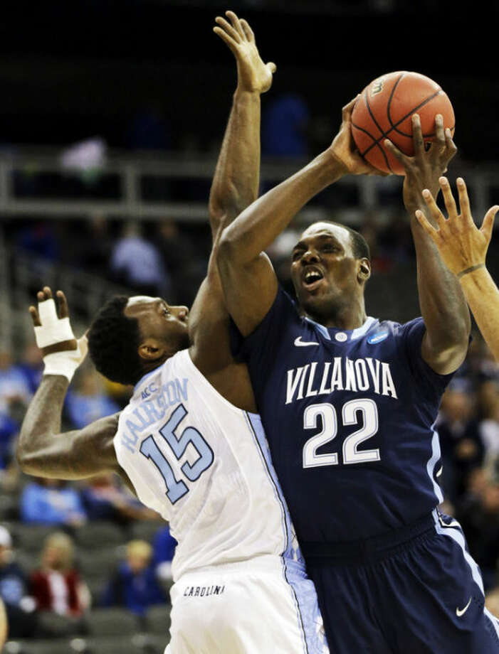 Villanova forward JayVaughn Pinkston (22) shoots as North Carolina guard P.J. Hairston (15) defends during the first half of a second-round game in the NCAA college basketball tournament at the Sprint Center in Kansas City, Mo., Friday, March 22, 2013. (AP Photo/Orlin Wagner)