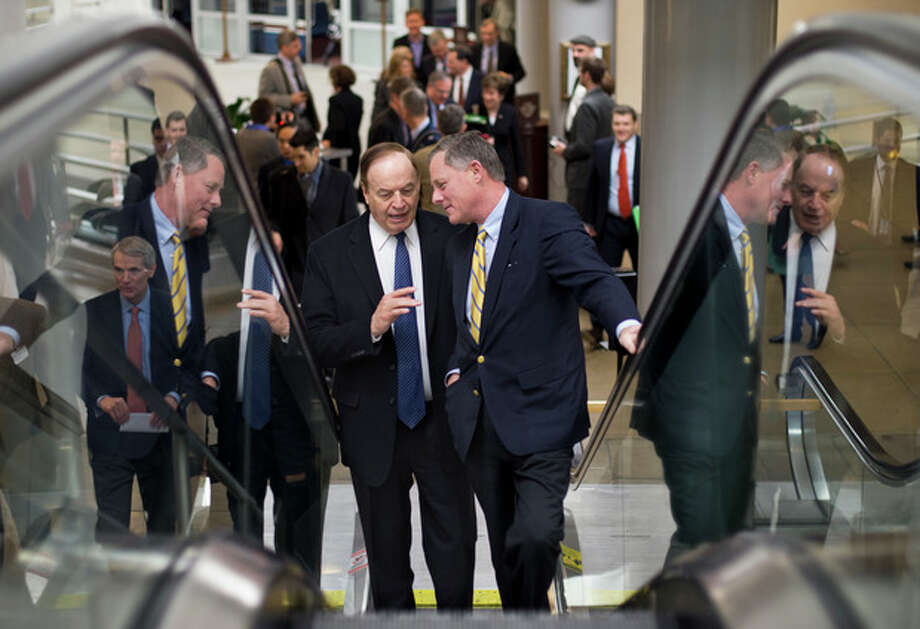 Sen. Richard Burr, R-N.C., right, talks with Sen. Richard Shelby, R-Ala., left, as they ride an escalator on Capitol Hill in Washington, Friday, March 22, 2013, as lawmakers rush to the Senate floor to vote on amendments to the budget resolution. (AP Photo/J. Scott Applewhite) / AP