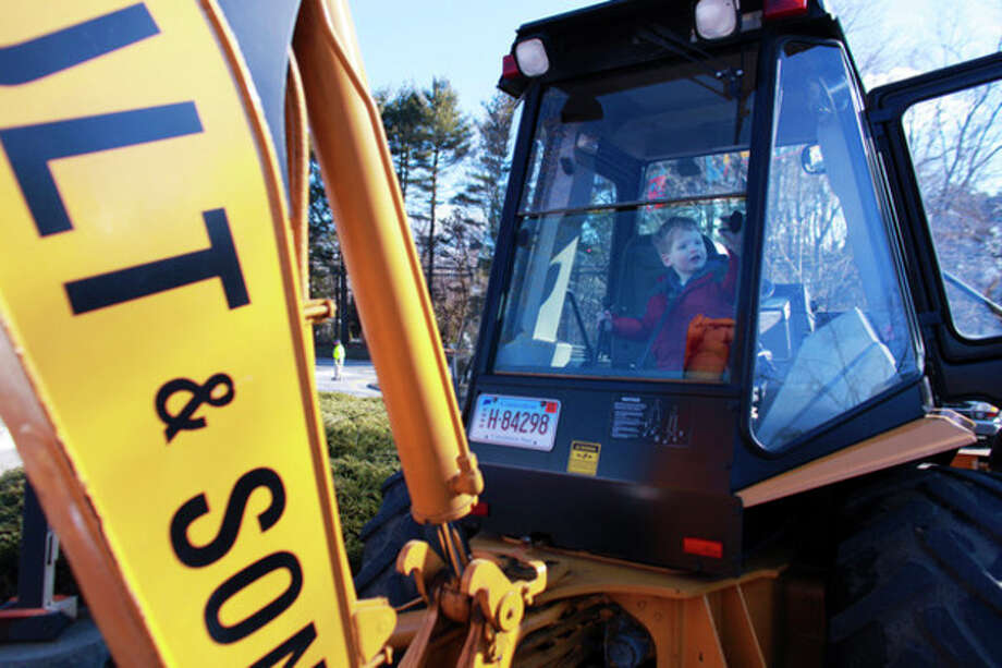 Mac Scully, 2, sits inside of a backhoe loader during Touch a Truck at Coleytown Elementary School in Westport on Saturday, March 23, 2013. (Hour Photo / Chris Palermo) / ©2013 The Hour Newspapers All Rights Reserved.