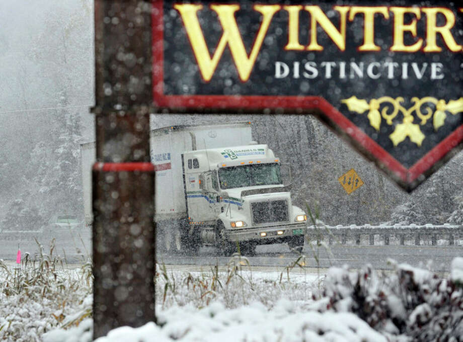 In this Thursday, Oct. 27, 2011 photo, a truck drives up Sherburne Pass on Route 4 in Killington, Vt., during a snowstorm. Killington received six inches of snow and another storm is predicted for Saturday night. (AP Photo/The Rutland Herald, Vyto Starinskas) / Vyto Starinskas/ Rutland Herald/ Please Credit