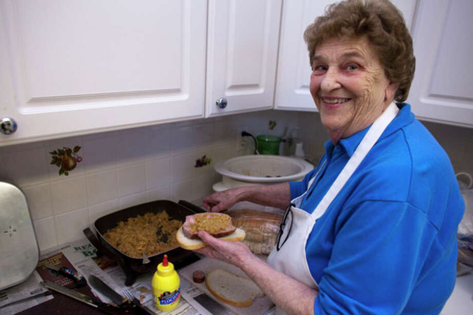 Rosemary Nemeth prepares a sandwich during the annual Easter Sale at the Calvin Reformed Church in Norwalk on Saturday, March 23, 2013. (Hour Photo / Chris Palermo) / ©2013 The Hour Newspapers All Rights Reserved.
