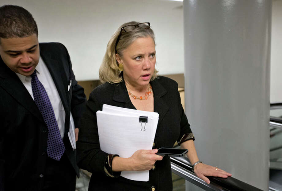 Sen. Mary Landrieu, D-La. rushes with other lawmakers to the Senate floor on Capitol Hill in Washington, Friday, March 22, 2013, to vote on amendments to the budget resolution. (AP Photo/J. Scott Applewhite) / AP