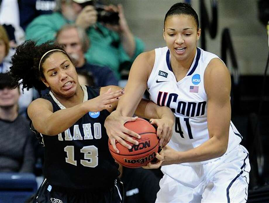 Idaho's Ali Forde, left, and Connecticut's Kiah Stokes fight for a rebound in the first half of a first-round game in the women's NCAA college basketball tournament in Storrs, Conn., Saturday, March 23, 2013. (AP Photo/Jessica Hill) / FR125654 AP
