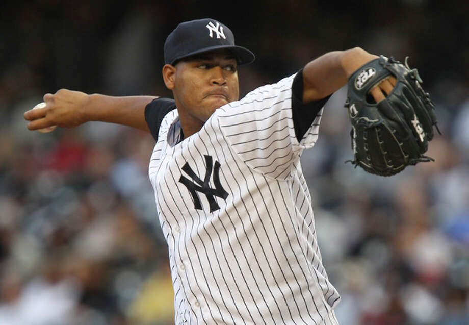 New York Yankees starting pitcher Ivan Nova works during the first inning of a baseball game against the Tampa Bay Rays at Yankee Stadium in New York, Wednesday, June 6, 2012. (AP Photo/Seth Wenig) / AP