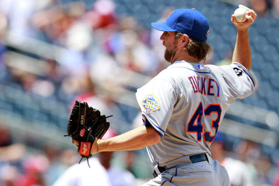 New York Mets starter R.A. Dickey pitches against the Washington Nationals during the second inning of a baseball game at Nationals Park in Washington, on Thursday, June 7, 2012. (AP Photo/Jacquelyn Martin) / AP