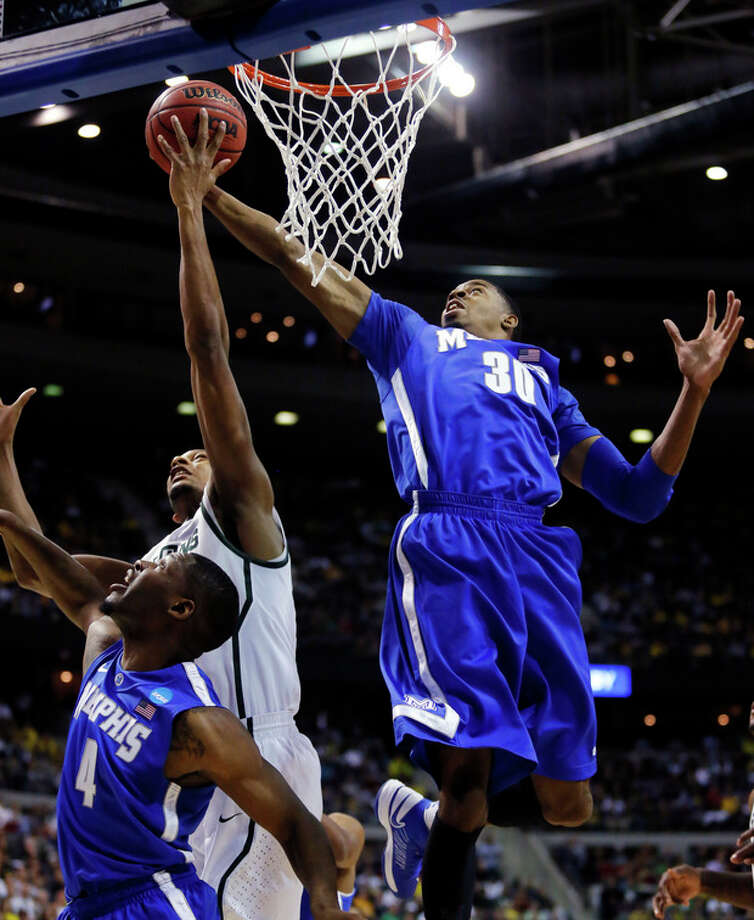 Memphis guard D.J. Stephens (30) blocks a shot by Michigan State forward Adreian Payne, left, as Memphis guard Adonis Thomas (4) helps defend on the play in the first half of a third-round game of the NCAA college basketball tournament, Saturday, March 23, 2013, in Auburn Hills, Mich. (AP Photo/Duane Burleson) / FR38952 AP