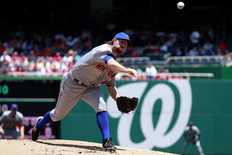 New York Mets starter R.A. Dickey pitches against the Washington Nationals during the first inning of a baseball game at Nationals Park in Washington, on Thursday, June 7, 2012. (AP Photo/Jacquelyn Martin) / AP