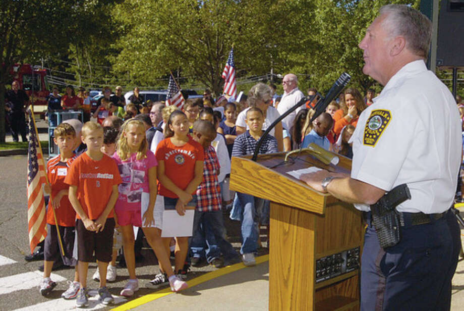 Norwalk police chief Harry Rilling addresses the students during a 9/11 commemoration ceremony at Fox Run School Friday. / (C)2011, The Hour Newspapers, all rights reserved