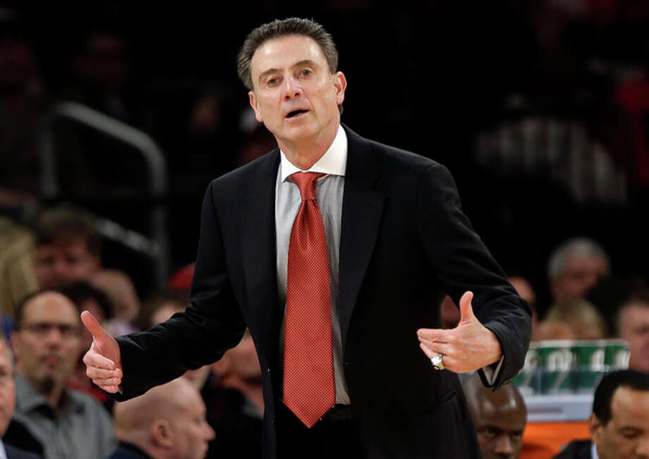 Louisville head coach Rick Pitino reacts during the first half of an NCAA college basketball championship game against the Syracuse at the Big East Conference tournament Saturday, March 16, 2013, in New York. (AP Photo/Frank Franklin II) / AP