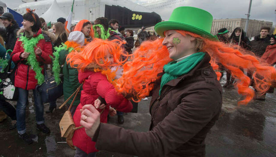 People dance during a St. Patrick's Day Parade in Moscow, Russia, Saturday, March 16, 2013. (AP Photo/Misha Japaridze) / AP