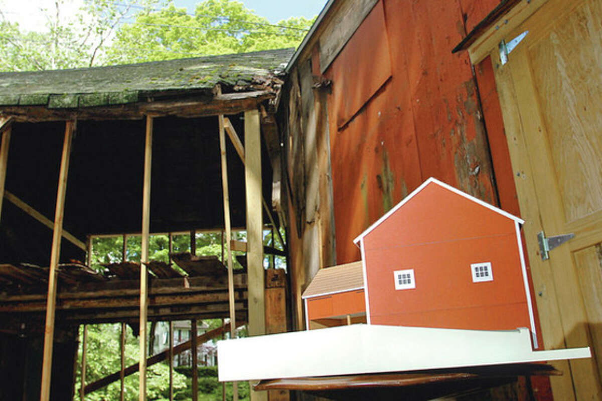 The Connnecticut Trust for Historic Preservation will present a check for $5,000 to the Wilton Congregational Church, for the stabilization of the Comstock Barns, located on the church parsonage property. Hour photo / Erik Trautmann