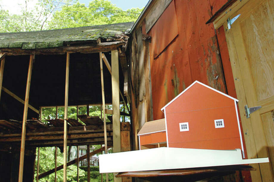 The Connnecticut Trust for Historic Preservation will present a check for $5,000 to the Wilton Congregational Church, for the stabilization of the Comstock Barns, located on the church parsonage property.Hour photo / Erik Trautmann / (C)2012, The Hour Newspapers, all rights reserved