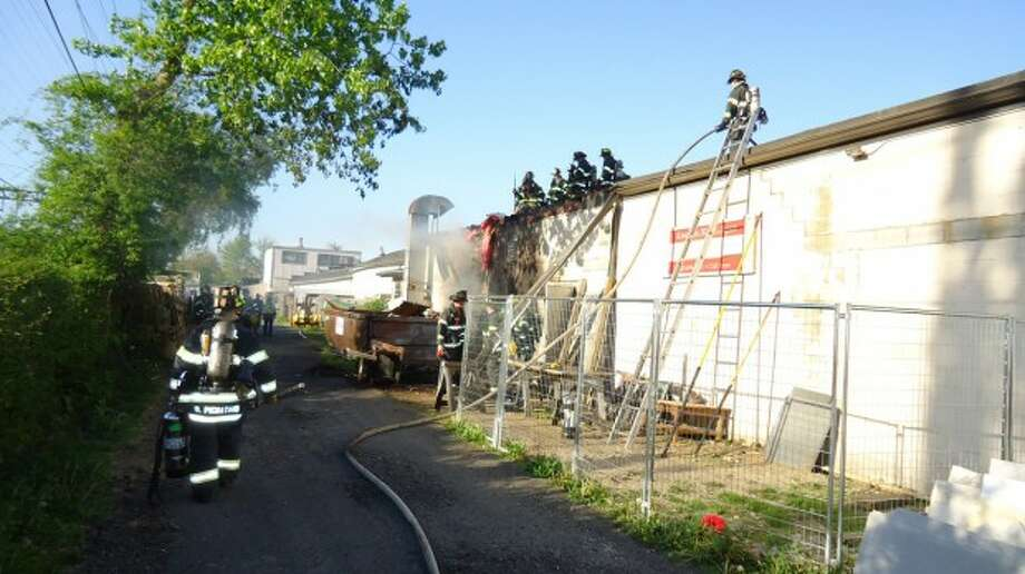 Norwalk fire quickly extinguishes spreading dumpster fire