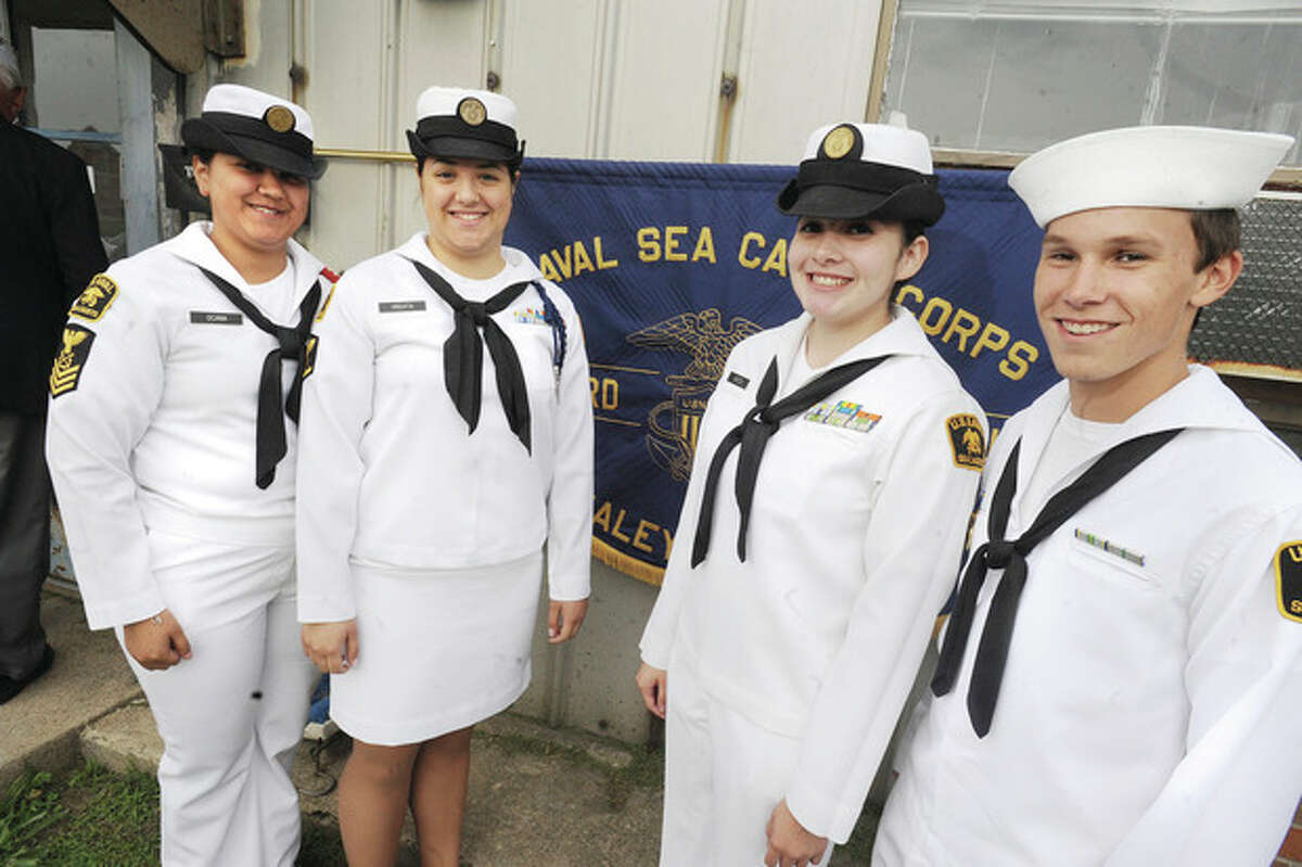 Photo by Matthew Vinci Four local high school students graduated Monday from the Naval Sea Cadet Corps in Stamford, including, from left, Lisa Ocana from Stamford, Manuela Higuita from Norwalk, and Vanessa Garzon and Ryan Beutler, who are both from Stamford.