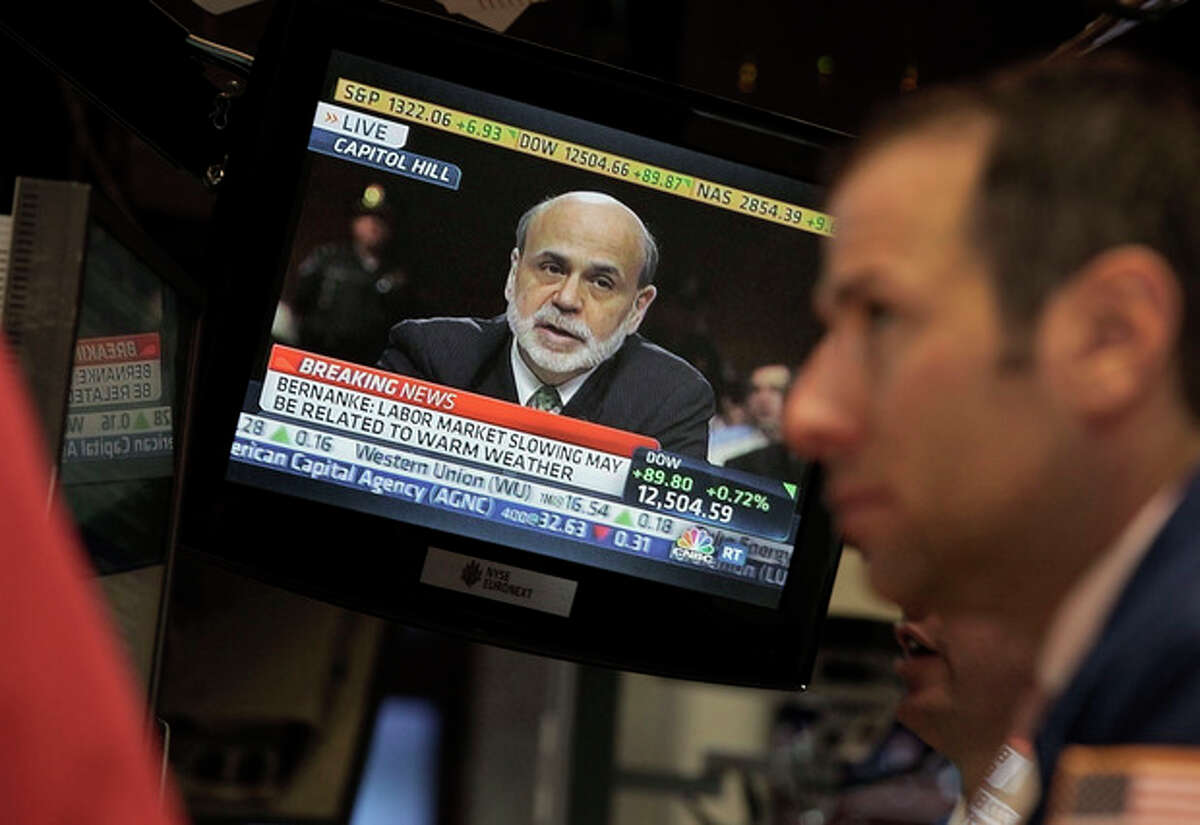 Federal Reserve Chairman Ben Bernanke appears on a television screen on the floor of the New York Stock Exchange Thursday, June 7, 2012. Bernanke said the Federal Reserve is prepared to take further steps to lift the U.S. economy if it weakens, but he didn't signal any imminent action in testimony before a congressional panel Thursday. (AP Photo/Richard Drew)
