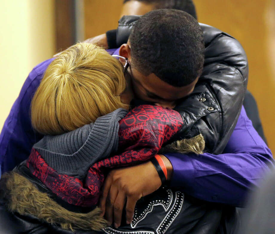 Ma'lik Richmond, 16, top, hugs his mother Daphne Birden, after closing arguments were made on the fourth day of the juvenile trial he and co-defendant Trent Mays, 17, on rape charges in juvenile court on Saturday, March 16, 2013 in Steubenville, Ohio. Mays and Richmond are accused of raping a 16-year-old West Virginia girl in August, 2012. Judge Thomas Lipps said he would render a decision on Sunday morning, March 17. (AP Photo/Keith Srakocic, Pool) / Pool, AP