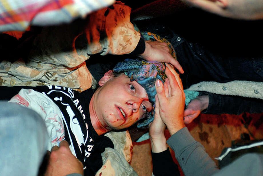 In this photo taken Tuesday, Oct. 25, 2011, 24-year-old Iraq War veteran Scott Olsen lays on the ground bleeding from a head wound after being struck by a by a projectile during an Occupy Wall Street protest in Oakland, Calif. Olsen suffered a fractured skull while marching with other protesters attempting to reestablish a presence in the area of the disbanded camp, said Dottie Guy, of the Iraq Veterans Against the War. Police Chief Howard Jordan says an internal review board and local prosecutors have been asked to determine if officers on the scene used excessive force. (AP Photo/Jay Finneburgh) / AP