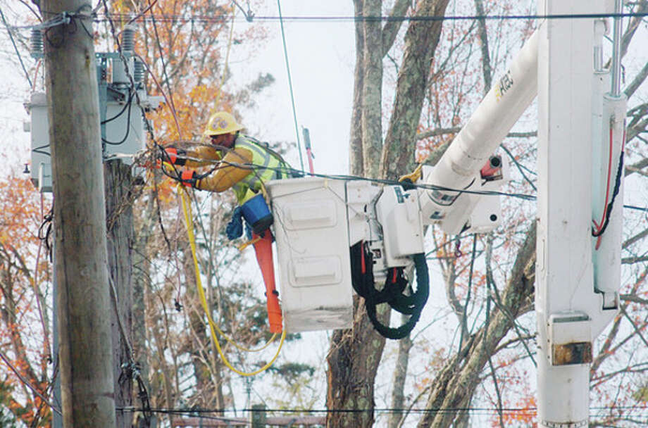 Workers with Aplundh Tree Service clear wires from fallen tree limbs on Mountain Rd in Wilton Tuesday following the Nor'Easter that left residents withourt power. Hour photo / Erik Trautmann / (C)2011, The Hour Newspapers, all rights reserved