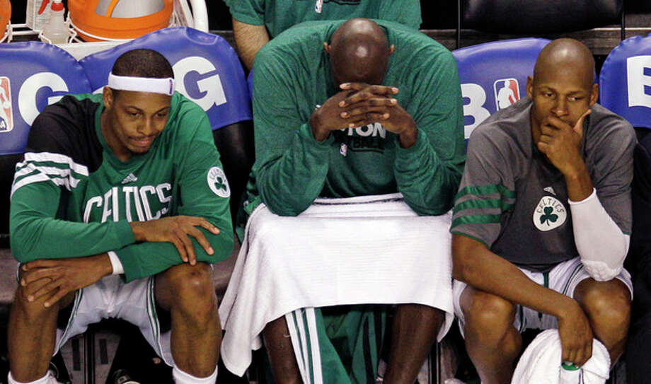 From left, Boston Celtics' Paul Pierce, Kevin Garnett and Ray Allen sit on the bench late in the fourth quarter while trailing the Miami Heat in Game 6 of the NBA basketball Eastern Conference finals, Thursday, June 7, 2012, in Boston. Miami won 98-79. (AP Photo/Charles Krupa) / AP