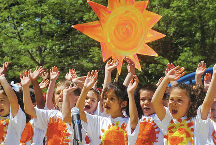 The Wolfpit Elementary School first graders sing Walking On Sunshine during school's end of year celebration, Wolfpit Day.Hour photo / Erik Trautmann / (C)2012, The Hour Newspapers, all rights reserved