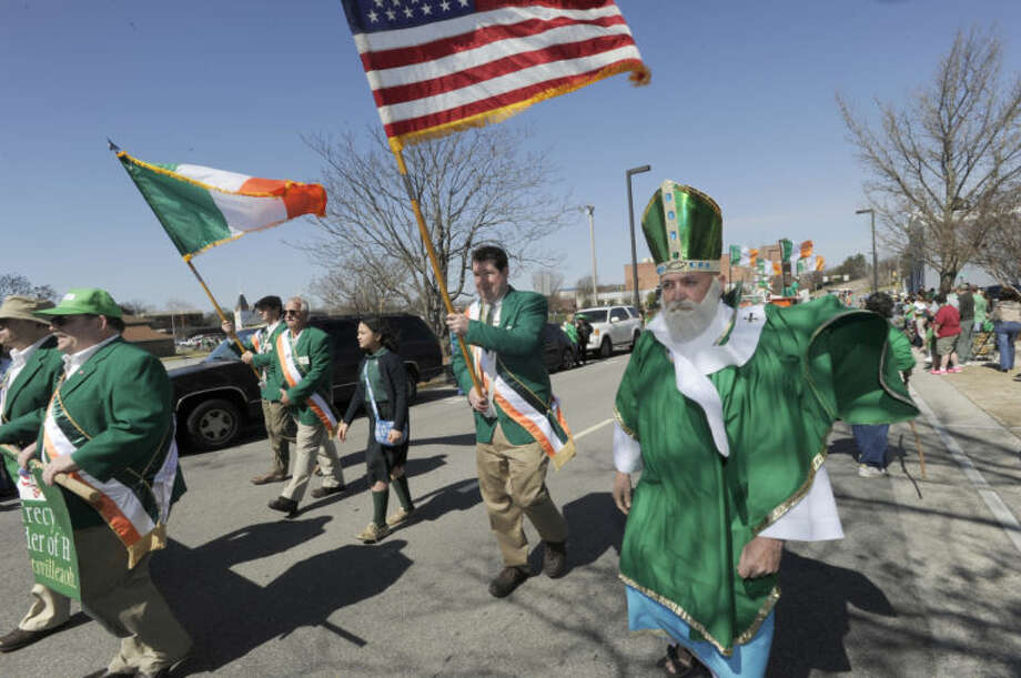 St. Patrick leads the color guard past St. Mary of the Visitation Church during the St. Patrick's Day Parade through downtown Saturday, March 16, 2013 in Huntsville, Ala. The 36th Annual Ellen McAnelly Memorial St. Patrick's Day Parade was the largest St. Patrick's Day on record. (AP Photo/Eric Schultz, AL.com)
