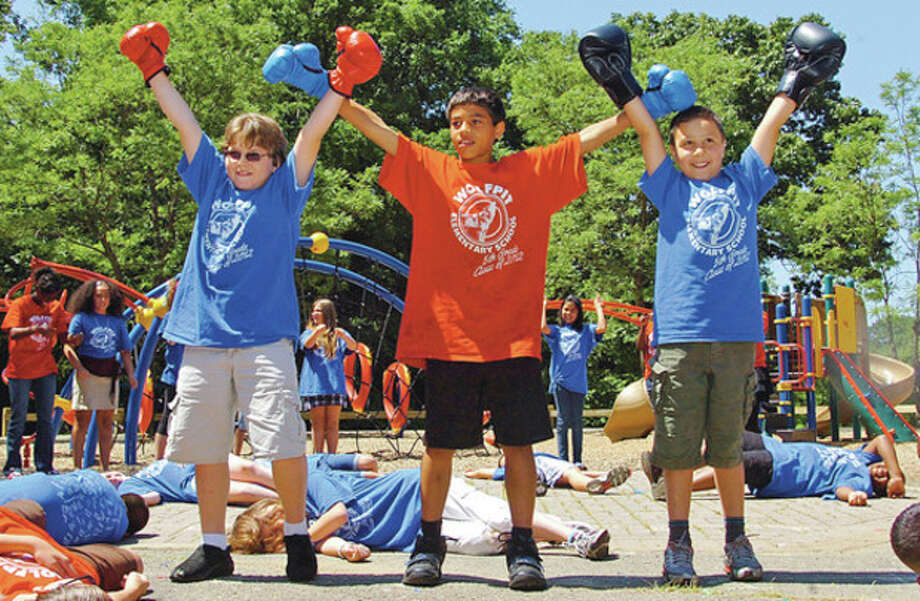 Fifth graders Sean Nicholson, Alec Cincotta and Anthony Mallozzi end Eye of The Tiger as Wolfpit Elementary School holds it end of year celebration, Wolfpit Day Friday.Hour photo / Erik Trautmann / (C)2012, The Hour Newspapers, all rights reserved