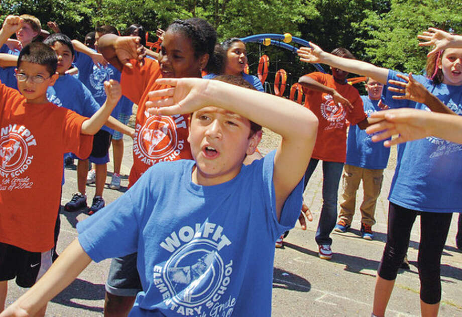 Fifth grader Samuel White sings We are the World with his class as Wolfpit Elementary School holds it end of year celebration, Wolfpit Day, Friday.Hour photo / Erik Trautmann / (C)2012, The Hour Newspapers, all rights reserved