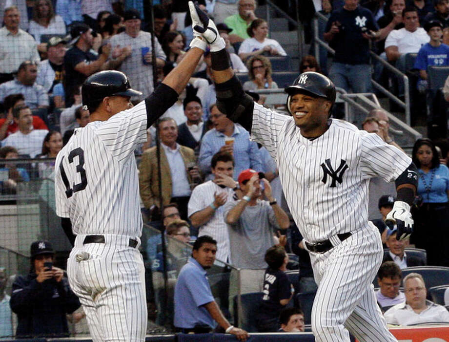 New York Yankees' Robinson Cano, right, celebrates with Alex Rodriguez (13) after hitting a two-run home run during the third inning of an interleague baseball game against the New York Mets on Friday, June 8, 2012, in New York. (AP Photo/Frank Franklin II) / AP