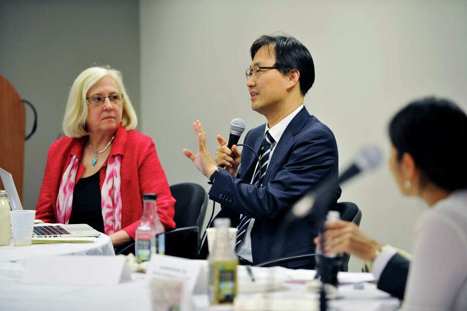 Dr. Patricia Bomba, left, VP and medical director, geriatrics, eMolst program director, Excellus BlueCross BlueShield, listens as Dr. Ilhak Lee, assistant professor at the College of Medicine, Yonsei University in Korea, addresses those gathered at an event at LeadingAge NY to talk about Medical Orders for Life-Sustaining Treatment (MOLST) in New York State on Monday, June 13, 2016, in Latham, N.Y.  A group from Korea was at the event to learn and to also share their ideas and experiences.     (Paul Buckowski / Times Union) Photo: PAUL BUCKOWSKI / 40036946A