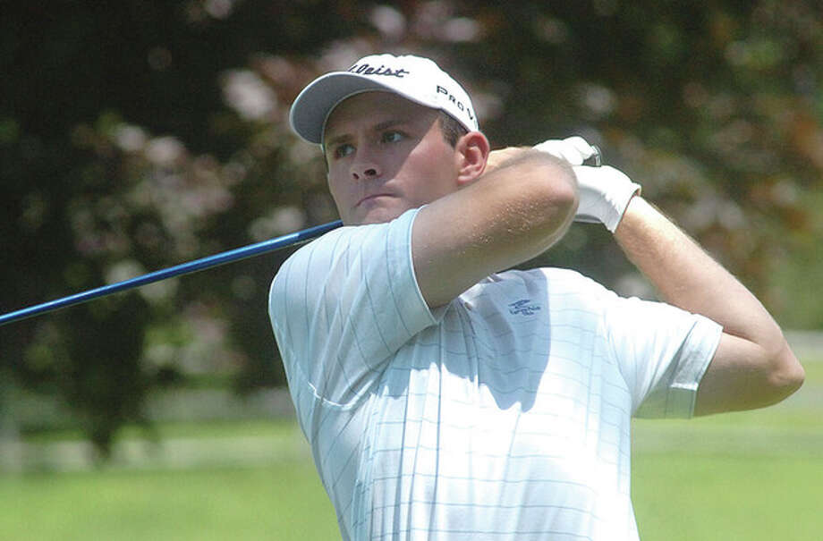 Hour Photo/Alex von Kleydorff John Murphy of Wilton follows the flight of his ball during MondayÕs first round of the Connecticut Amateur Golf Championship being played at Rolling Hills Country Club in Wilton. Murphy finished the day in a tie for third. The tournament runs through Friday. / 2011 The Hour Newspapers